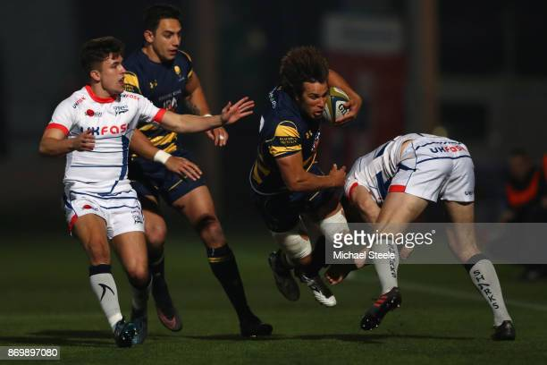 Dean Hammond of Worcester is upended during the AngloWelsh Cup match between Worcester Warriors and Sale Sharks at Sixways Stadium on November 3 2017...