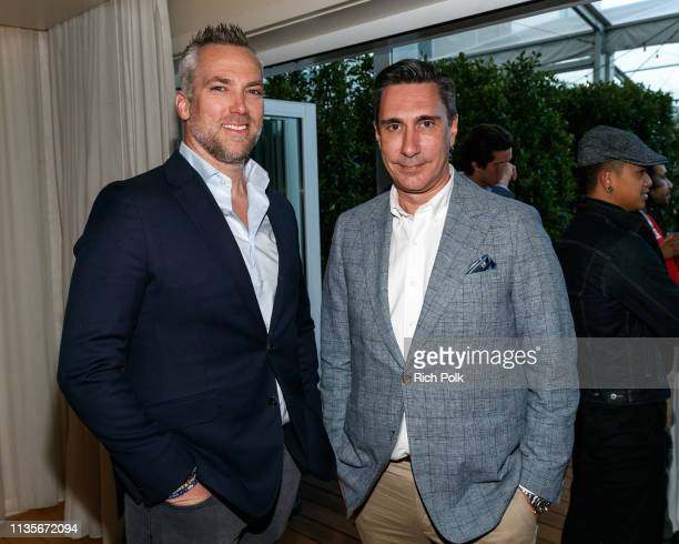 Dean Handspiker poses for a photo with a guest at the Indochino Los Angeles Spring/Summer '19 Launch Party at SkyBar at the Mondrian Los Angeles on...