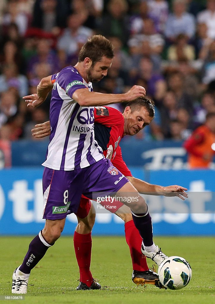 Dean Heffernan of the Glory and Cameron Watson of Adelaide contest for the ball during the round twenty seven A-League match between Perth Glory and Adelaide United at nib Stadium on March 30, 2013 in Perth, Australia.