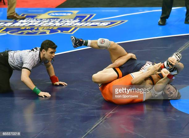 Dean Heil of Oklahoma State tries to get a near fall on George DiCamillo of Virginia in the finals of the 141pound weight class of the NCAA Wrestling...