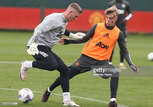 Dean Henderson and Brandon Williams of Manchester United in action during a first team training session at Aon Training Complex on September 28 2020...