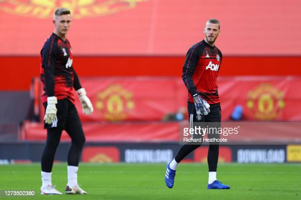 Dean Henderson and David De Gea of Manchester United looks on during the warm up prior to the Premier League match between Manchester United and...