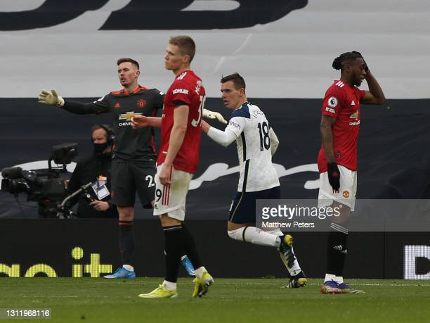 Dean Henderson and Scott McTominay of Manchester United react to concending a goal to Heung-Min Son of Tottenham Hotspur during the Premier League...
