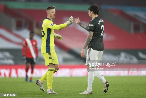 Dean Henderson and Victor Lindelof of Manchester United shake hands after the Premier League match between Southampton and Manchester United at St...