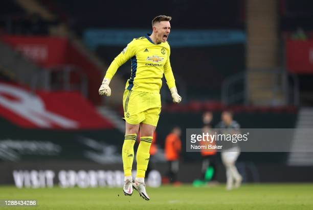 Dean Henderson of Manchester United celebrates after their sides second goal scored by team mate Edinson Cavani during the Premier League match...