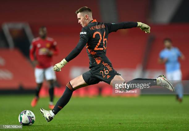 Dean Henderson of Manchester United clears the ball during the Carabao Cup Semi Final match between Manchester United and Manchester City at Old...