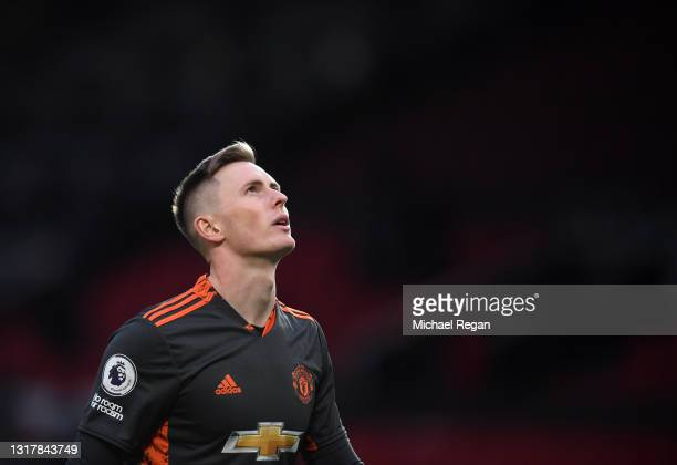 Dean Henderson of Manchester United looks on prior to the Premier League match between Manchester United and Liverpool at Old Trafford on May 13,...
