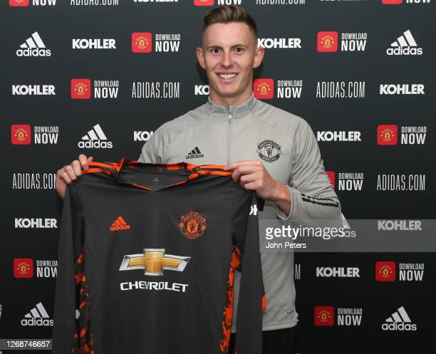 Dean Henderson of Manchester United poses after signing a new contract with the club at Aon Training Complex on August 26, 2020 in Manchester,...