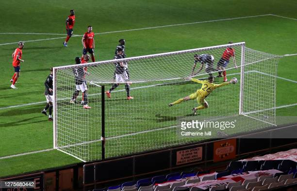 Dean Henderson of Manchester United saves a shot during the Carabao Cup Third Round match between Luton Town and Manchester United at Kenilworth Road...