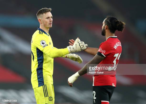 Dean Henderson of Manchester United shakes hands with Theo Walcott of Southampton after the Premier League match between Southampton and Manchester...