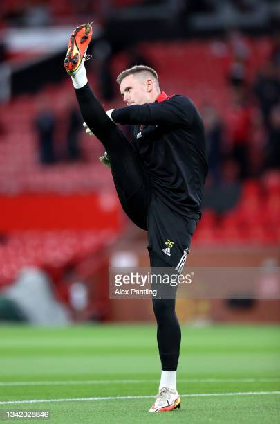 Dean Henderson of Manchester United warms up prior to the Carabao Cup Third Round match between Manchester United and West Ham United at Old Trafford...