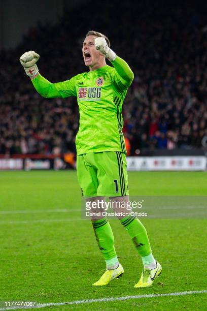 Dean Henderson of Sheffield United celebrates at full time during the Premier League match between Sheffield United and Arsenal FC at Bramall Lane on...