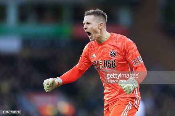 Dean Henderson of Sheffield United celebrates his team's first goal during the Premier League match between Norwich City and Sheffield United at...