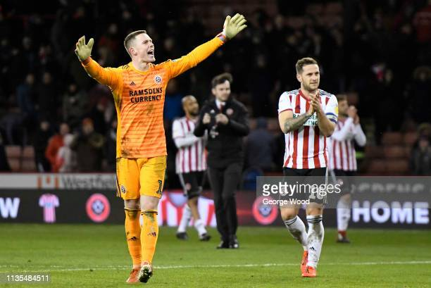 Dean Henderson of Sheffield United celebrates victory after the Sky Bet Championship match between Sheffield United and Brentford at Bramall Lane on...