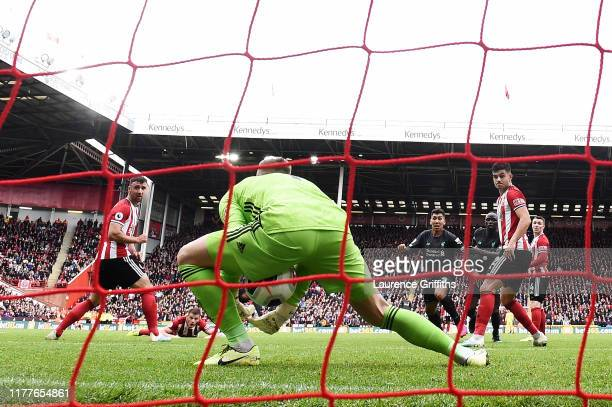 Dean Henderson of Sheffield United fails to saves Georginio Wijnaldum of Liverpool shot which leads to Liverpools first goal during the Premier...