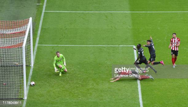 Dean Henderson of Sheffield United fails to saves Georginio Wijnaldum of Liverpool shot which leads to Liverpools first goal duringduring the Premier...