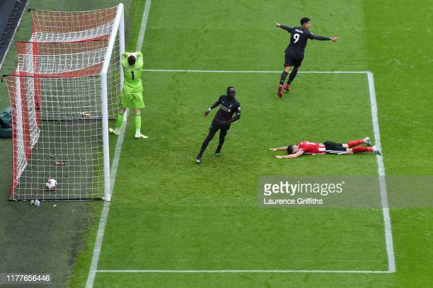 Dean Henderson of Sheffield United reacts to Georginio Wijnaldum of Liverpool scoring Liverpool's first goal as Sadio Mane and Roberto Firmino of...
