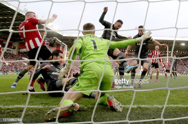 Dean Henderson of Sheffield United saves a shot from Mario Vrancic of Norwich City during the Premier League match between Sheffield United and...
