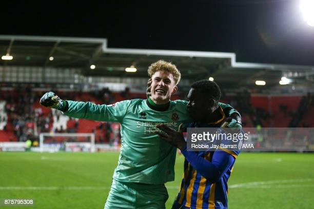 Dean Henderson of Shrewsbury Town and Aristote Nsiala of Shrewsbury Town celebrates at full time during the Sky Bet League One match between...