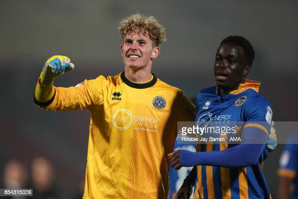 Dean Henderson of Shrewsbury Town and Arthur Gnahoua of Shrewsbury Town celebrate at full time during the Sky Bet League One match between Doncaster...