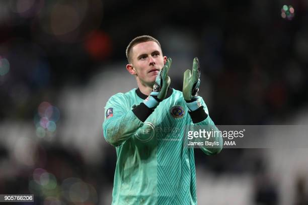 Dean Henderson of Shrewsbury Town applauds the fans at the end of the Emirates FA Cup Third Round Repaly match between West Ham United and Shrewsbury...