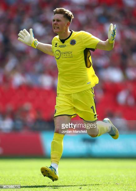 Dean Henderson of Shrewsbury Town celebrates as Alex Rodman of Shrewsbury Town scores his sides first goal during the Sky Bet League One Play Off...