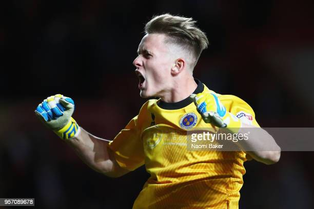 Dean Henderson of Shrewsbury Town celebrates at the full time whistle after his side wins the match during the Sky Bet League One Play Off Semi Final...