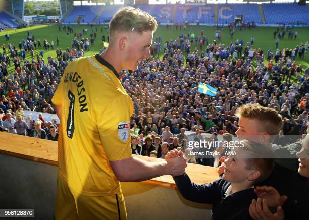Dean Henderson of Shrewsbury Town celebrates with a young supporter at full time after the Sky Bet League One Play Off Semi FinalSecond Leg between...