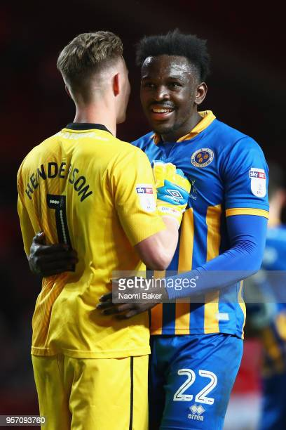 Dean Henderson of Shrewsbury Town celebrates with Aristote Nsiala of Shrewsbury Town at the full time whistle after his side wins the match during...