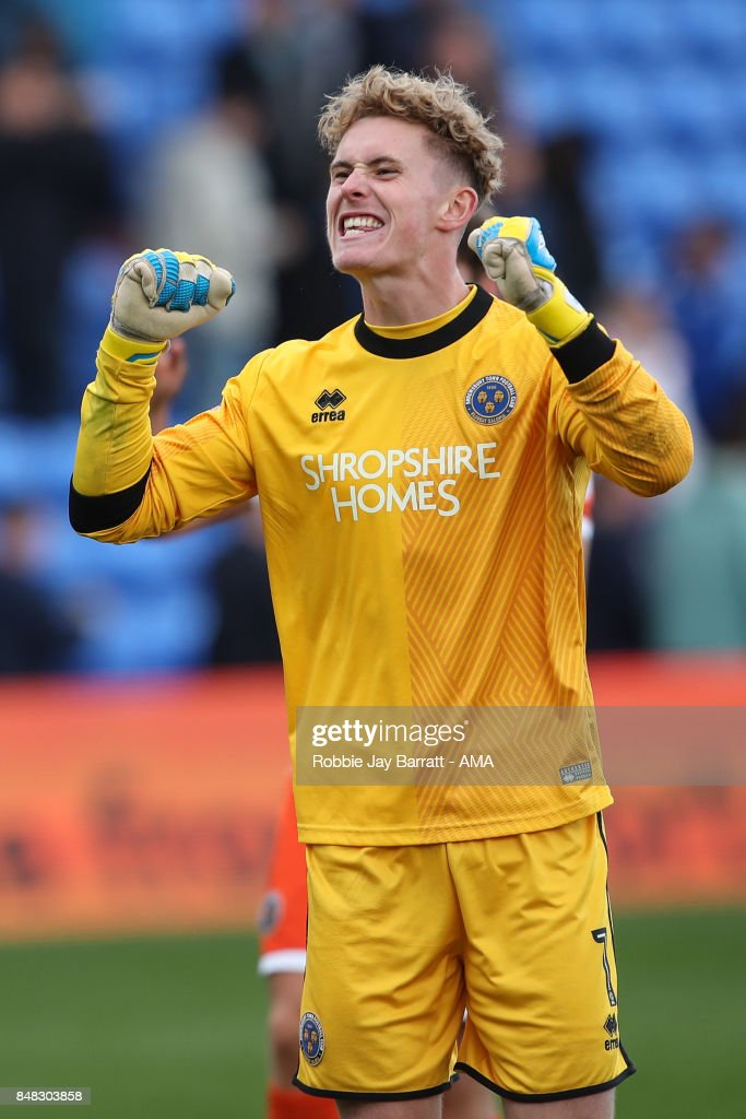Dean Henderson of Shrewsbury Town celebrates with the fans at full time during the Sky Bet League One match between Oldham Athletic and Shrewsbury Town at Boundary Park on September 16, 2017 in Oldham, England.