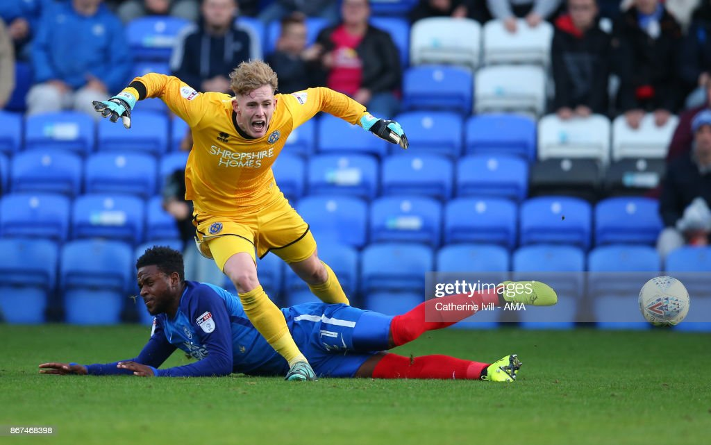 Dean Henderson of Shrewsbury Town is tackled by Jermaine Anderson of Peterborough United during the Sky Bet League One match between Peterborough United and Shrewsbury Town at ABAX Stadium on October 28, 2017 in Peterborough, England.