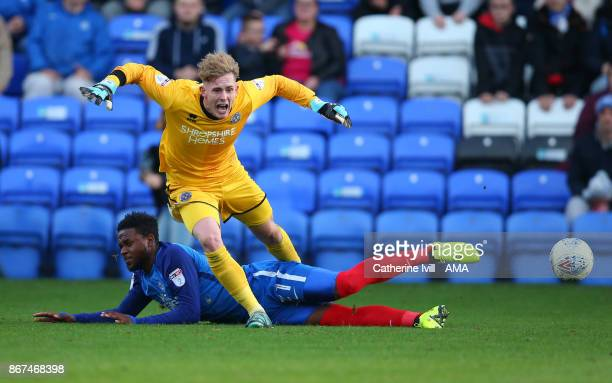 Dean Henderson of Shrewsbury Town is tackled by Jermaine Anderson of Peterborough United during the Sky Bet League One match between Peterborough...