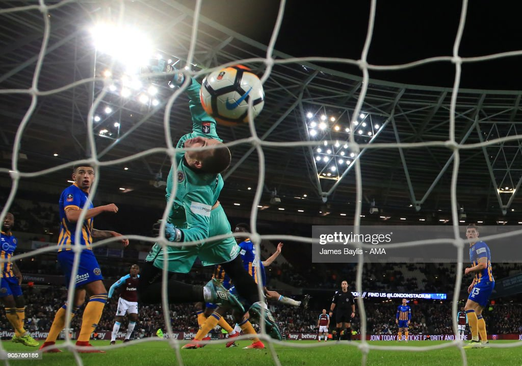 Dean Henderson of Shrewsbury Town is unable to stop Reece Burke of West Ham United scoring a goal to make it 1-0 in extra time during the Emirates FA Cup Third Round Repaly match between West Ham United and Shrewsbury Town at London Stadium on January 16, 2018 in London, England.
