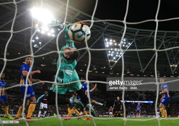 Dean Henderson of Shrewsbury Town is unable to stop Reece Burke of West Ham United scoring a goal to make it 10 in extra time during the Emirates FA...