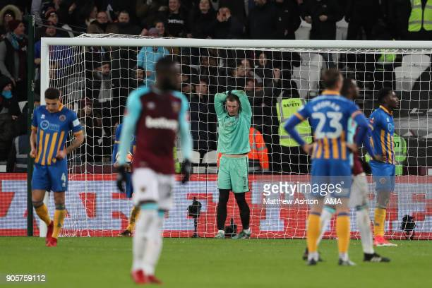Dean Henderson of Shrewsbury Town looks dejected after West Ham scored in extra time during the Emirates FA Cup Third Round Repaly match between West...