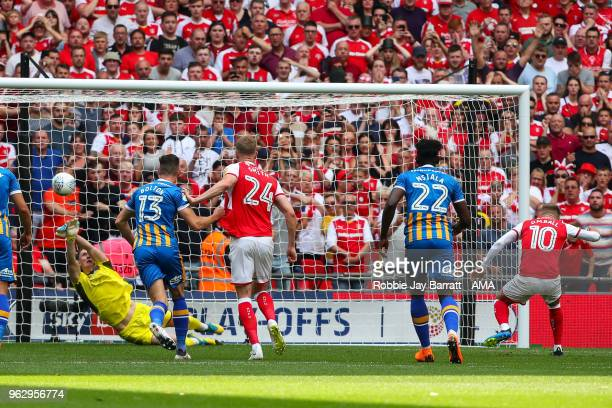 Dean Henderson of Shrewsbury Town saves a penalty from David Ball of Rotherham United during the Sky Bet League One Play Off Final between Rotherham...