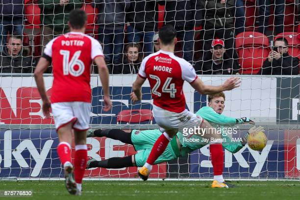 Dean Henderson of Shrewsbury Town saves a penalty from Kieffer Moore of Rotherham United during the Sky Bet League One match between Rotherham United...