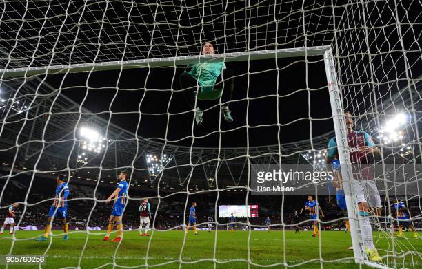 Dean Henderson of Shrewsbury Town swings on the crossbar during The Emirates FA Cup Third Round Replay match between West Ham United and Shrewsbury...