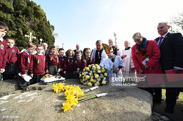 Dean Henry Hull lays a wreath at the grave of Saint Patrick during the annual Saint Patrick's Day service and pilgrimage from Saul church to...