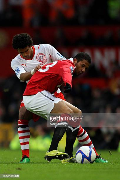 Dean Howell of Crawley Town fights for the ball with Tiago Bebe of Manchester United during the FA Cup sponsored by EON 5th round match between...