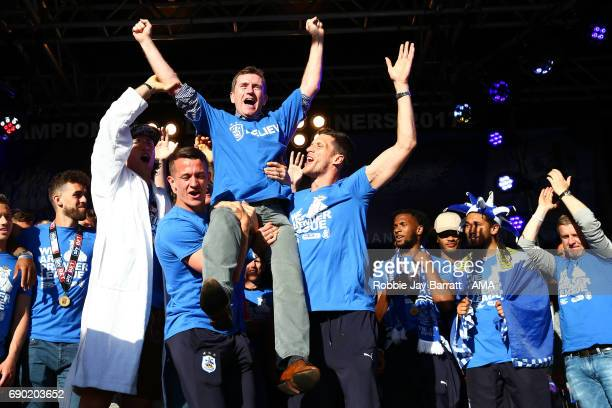 Dean Hoyle chairman / owner of Huddersfield Town is lifted aloft by Jonathan Hogg of Huddersfield Town and Mark Hudson of Huddersfield Town on May...