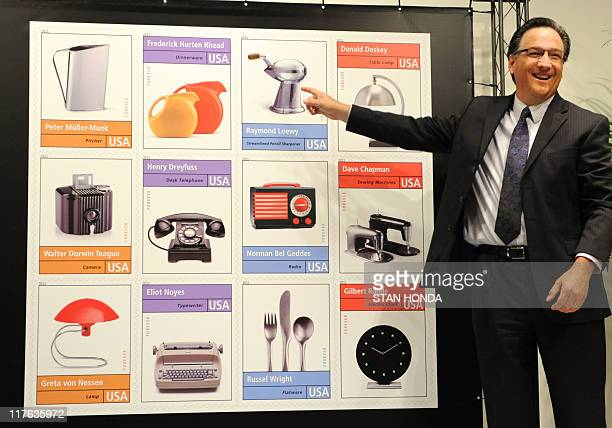 Dean J Granholm Vice President Delivery and Post Office Operations of the US Postal Service points to his favorite design of a pencil sharpener by...