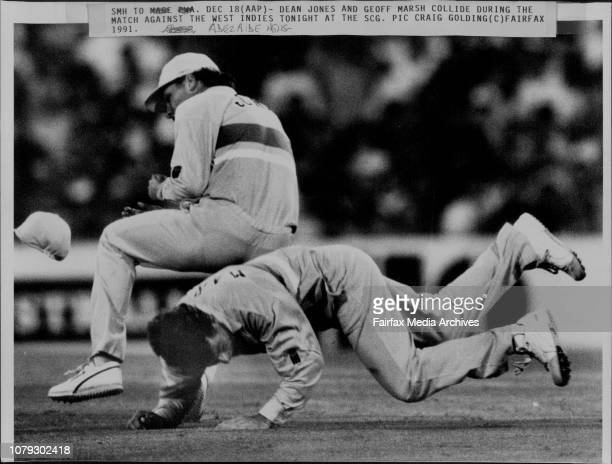 Dean Jones and Geoff Marsh collide during the match against the West Indies tonight at the SCG December 18 1991