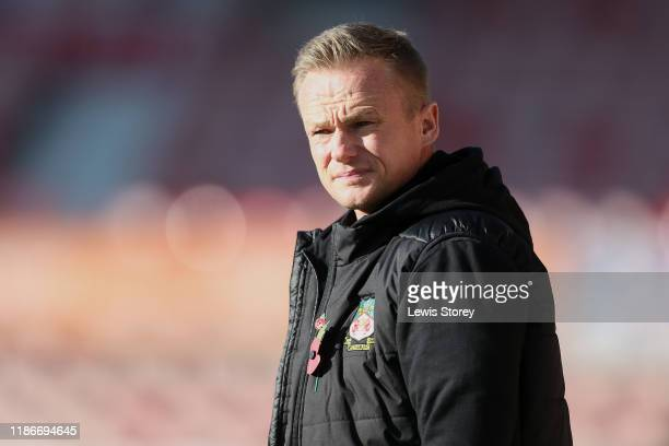 Dean Keates manager of Wrexham looks on prior to the FA Cup First Round match between Wrexham and Rochdale at Racecourse Ground on November 10 2019...