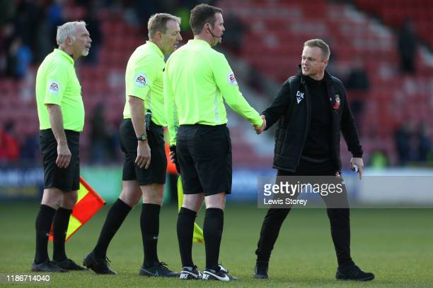 Dean Keates manager of Wrexham reacts to the officials after the FA Cup First Round match between Wrexham and Rochdale at Racecourse Ground on...