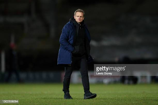 Dean Keates, Manager of Wrexham walks across the pitch after the the Vanarama National League match between between Wrexham and Woking at Racecourse...