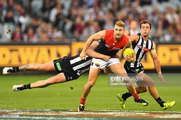 Dean Kent of the Demons is tackled by Jordan de Goey of the Magpies during the round four AFL match between the Collingwood Magpies and the Melbourne...