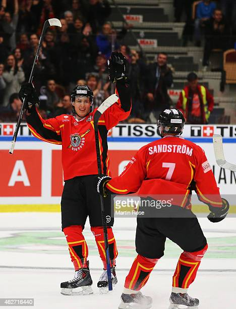 Dean Kukan of Lulea Hockey celebrates scoring his team's fourth goal with Jan Sandstrom during the Champions Hockey League Final match between Lulea...