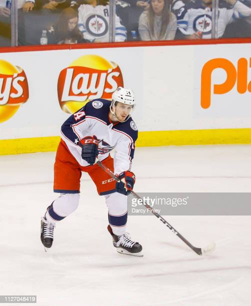 Dean Kukan of the Columbus Blue Jackets keeps an eye on the play during second period action against the Winnipeg Jets at the Bell MTS Place on...