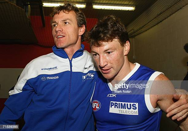 Dean Laidley and Brent Harvey of the Kangaroos embrace after the round 17 AFL match between the Kangaroos and the Geelong Cats played at Manuka Oval...